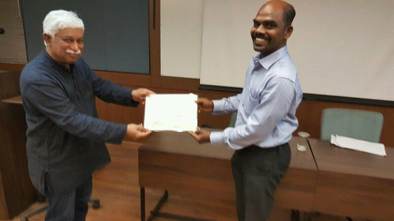 Dr Ravi Poovaiah distributing the IxD course in IDC Mumbai